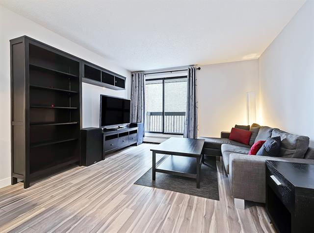 You will not want to miss this lovely renovated condo in the heart of Windsor Park. Pride of ownership is evident through out ...it is move in ready and just 2 blocks to Chinook Mall and a quick walk to the shops of Britannia, Village Ice Cream and Sandy Beach! This property is a must see!  Upon entry you will be thrilled with the  spacious living room  with sliding glass doors to an outdoor deck perfect for enjoying these summer evenings...the dining area can host several for dinner and is adjacent to the kitchen.  Two exceptionally large bedrooms are a great feature and there is an ample in-suite storage room ready to accommodate an extra fridge or freezer too... recent upgrades include laminate floors thru out, doors, casings  & baseboards.  Underground secure parking makes this condo is a winner !!