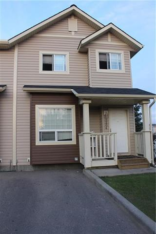 Welcome to this Beautiful Taradale townhome! Close to transit, the LRT, schools, library, shopping, recreation and parks! Showcasing pride of ownership, this home is clean & well-maintained; over 1,350 sq. ft. across three developed levels of living space. On the main level, high 9' ceilings, neutral tones and an open-concept layout; with the living room centering on a big window. The kitchen features rich cabinetry, a black appliance package & a breakfast bar; the adjacent nook opens to a patio perfect for BBQs and has a gasline in place! Upstairs, the large master bedroom offers a sitting area and walk in closet, there are two more good size bedrooms and full washroom . The lower level is unfinished and awaits for your personal touch and requirement with a big size window. Situated in a complex with low condo fees, parking stall conveniently located directly in front & visitor parking is just in front of unit. Great value & move in ready!