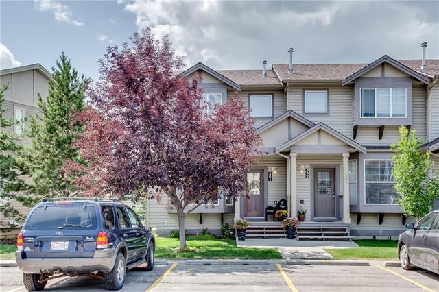 PRICE REDUCTION!   Bright and clean Airdrie townhouse!  End unit, backs onto a huge green space.  Efficient kitchen with raised breakfast bar and dining nook.  Pride of ownership shows with beautiful modern fixtures and backsplash.  Huge windows at both ends of the main floor means plenty of natural light. Large living room and a two piece bath complete the main floor.  Upstairs is a spacious master bedroom with walk in closet, a second bedroom and a cozy loft area (can be converted to a third bedroom),  perfect for TV viewing or reading.  The basement is fully developed with a rec room, three piece bath, separate laundry area and plenty of storage.  Lovely wooden decks on both the entrance and off the kitchen. New hot water tank and new roofing done in 2015. Ample parking with two stalls plus visitor parking. Easy access to shopping, schools and recreational areas.  This is an immaculately kept home in a well managed, clean condo property.