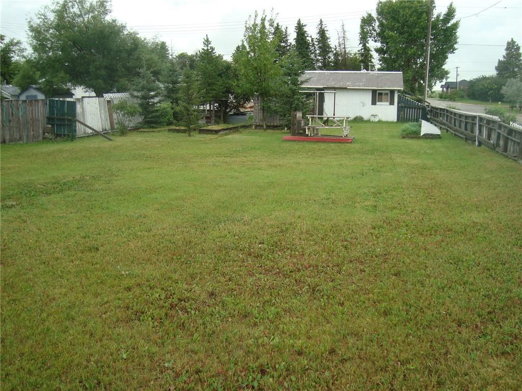 Corner Residential lot with older single garage ready for you to build in established area. R-2 zoning