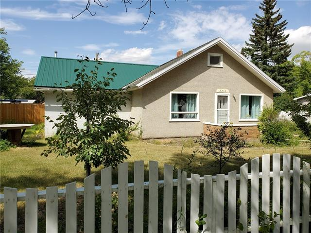 """Mature oversized 85' x 120' lot offering 10,200 sq.ft of space with great proximity to the downtown core of Nanton. Located on the lot is a 1178 sq.ft 1 1/2 story home with cinder block addition.Come check out the new kitchen that was just recently installed that includes a new stove and new dishwasher. The main floor houses the laundry at the back entry, bathroom, living room, kitchen, bedroom, den, family room addition that has a new gas heater and provides access to an unheated 18'5"""" x 7'8"""" workshop. The upper level has a bedroom and a small sitting area, this area is not included in the total sq.ft. due to the ceiling height not meeting RMS standards of 7'. There is a greenhouse prep space, 2 storage sheds & RV parking on the property plus lots of fruit trees, raspberries, rhubarb & perennials. Great for first time buyers or an investment property, buy now, rent the house out and see the potential for future development on this spacious lot with great location and maturity. New hot water tank in 2019."""