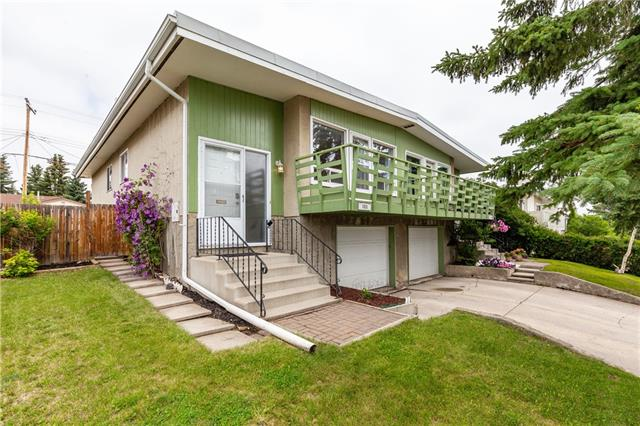 Perfect starter home in the established community of North Haven!  Views of Nose Hill and partial Down Town views.  This bright and spacious bi-level features; original oak plank hardwood floors, ceramic tiled floors and a sunny front balcony, perfect for enjoying your morning coffee or an evening BBQ.  The top floor comes complete with 3 spacious bedrooms, (One of the bedroom's offering patio door access to the deck and rear yard), kitchen, living room/dining area and a full 4 piece bathroom.  Downstairs you have access to your single attached garage, workshop (access off the garage), open family room and a 3 piece bathroom with newly tiled shower surround.  The home also comes with a ton of storage space!   Plenty of room for the kids to play in the large fenced rear yard The home sits on a quiet street close to Nose Hill Park, public transit, local schools, shopping and more!  Owning your own home may be closer than you think!  See notes below for additional info...