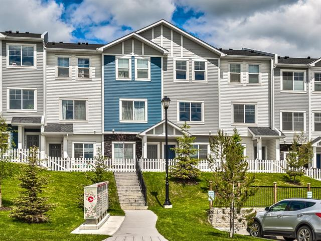 Open House Saturday Aug 24 from 11am - 1 pm. This gorgeous double master townhome features some of the best views in the entire complex overlooking the environmental reserve, the South facing exposure ensures ample light in the home all day long. This home has a finished garage, main floor den, 9 foot ceilings and an enormous Island with chef inspired kitchen. The upper floor has two large bedrooms with two full bathrooms,  and upper floor laundry. All the finishings in this unit are top notch and need to be seen to be appreciated.
