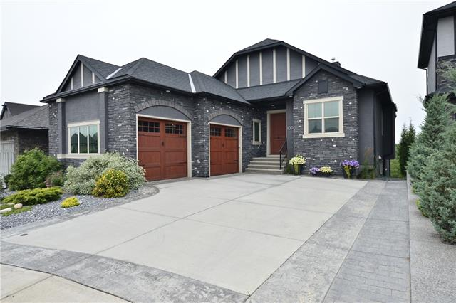 Immaculate Bungalow on the Ridge! West facing with Fantastic 180 Degree Views including the Rocky Mountains. This Walk-out Bungalow offers 3,238 SqFt of living space with tons of upgrades & quality finishes. As you enter, you're greeted with Huge Vaulted Ceilings & lots of Windows giving Bright Natural Sunlight. The Kitchen comes with Chocolate Cabinets, Upgraded Stainless Appliances, a Large Center Island & a Walk-through Pantry. The Master Bedroom has an attractive en-suite with heated floors, large walk-in closet, & access to the deck which runs the entire width of the house. This floor also has 10 Ft Ceilings with 8 Ft Doors, Fireplace, Office, 2pc bathroom, & a Mudroom with Laundry. The Walk-out Level has 2 living rooms, workout area, wet bar, Fireplace, full bathroom, & 2 bedrooms. The $75K breath-taking Backyard has a Gas Firepit, Powered Sun Shades, a Pergola & Concrete from end to end. Luxuries include: Air conditioning, 4 Zone Sound System, $25K Window Coverings, Triple Glazed Low E Windows...