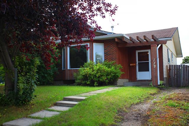 Sweet 4 bedroom bungalow with a WALK-UP BASEMENT creating excellent potential for a basement rental! Enjoy peace and quiet on a street safe cul de sac very close to elementary, junior and senior high schools. It has an attractive plan with a sunken entry way leading to a large living room featuring a bright bay window. Enjoy the convenience of the space-saver kitchen with dinette! Total of 4 bedrooms, 2 full baths, and a finished basement with rec room, family room, laundry room with a large freezer, and basement walk-up. Bright patio doors lead from the main floor master bedroom to the lush backyard with a warm and sunny south exposure. Upgrades include the furnace, hot water tank, and some newly insulated windows. Shopping is near by. This is a very affordable, cozy home with with terrific potential!