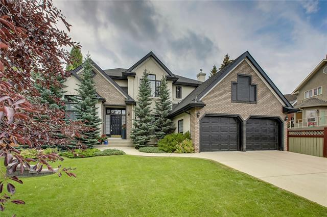 Outstanding family home in one of Calgary's best communities. RARE 9 Ft MAIN FLOOR CEILINGS. This impressive Tudor style home has amazing curb appeal & over 3700 Sq. Ft. of devel living space. The main floor boasts large principal rooms, soaring vaulted ceilings, hardwood floors, custom window coverings, a formal living /dining rm, & a family rm w/ gas fireplace. The remodelled kitchen w/ nook has high end stainless steel appliances (subzero fridge), & granite countertops. The big windows fill the home w/ sunlight & give full views of your beautiful south facing backyard. The renovated upper level is perfect for families w/ 4 large bedrooms including an expansive master w/ spa like ensuite w/double sinks, soaker tub & a separate shower. The updated basement features a home gym, 2nd office (or 5th Bedroom), games room, theatre area, bar & bathroom w/steam shower. Christie Estates is well located close to 2 c-train stations, & offers plenty of green spaces / playgrounds, & natural ravine areas (Wildlife!)
