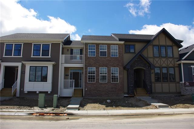 "Welcome Home ! This beautiful Townhome Built by Douglas Homes ""The York""  2-Storey,  features 2 bedrooms, 2.5 bathrooms. The home is located in the Airdrie, in the sought after community of Coopers Crossing  2 Master Bedrooms each with a Private en-suite , a total of 2.5 Bathrooms, Upper Floor Laundry, Hardwood and Tile throughout Main Floor, 9? Ceilings on Main Floor, Large Bright Windows, Quartz Countertops, Wrought Iron Railings.  More Design Highlights : Balcony, Full Brick exterior Wall giving this home a ton of elegance. Large 20? x 20? Garage. Come and take a look! Other lots and home designs available as well."