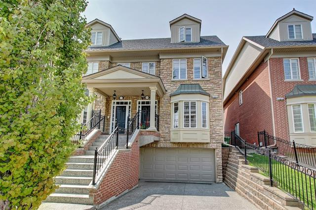 PRICE DROP SEPT 19! Welcome to a well appointed 3-storey townhouse that backs onto the pathway & Elbow River. An END UNIT rarely comes to market. Additional light & the convenience of transporting patio furniture & plants to the rear deck is a huge bonus. Main level has new dark brown hardwood throughout. A spacious living area with gas fireplace. The L shaped kitchen has SS appliances (gas range), granite counter tops, & island eating bar. The dining room is large & will accompany a large group. Patio doors off living room lead to a 2 tiered deck (west facing). Home backs onto environmental reserve, pathway & steps to the river. 2nd level has 2 spare bedrooms, 4 piece bathroom, mechanical room, and den with west exposure overlooking DT and river. The 3rd level (top) has the master bedroom to retire to. Walk in closet, fireplace, patio, and large deck overlooking the river with DT views. New AC unit added to this level. The ensuite has a walk-in shower (steam option), dual sinks, cabinets & soaker tub.