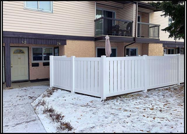 *PRICE REDUCD TO SELL* * UPDATED UNIT SHOWS GREAT!!! Lots of TLC has whipped this unit into showroom condition. Featuring new flooring, neutral paint, baseboards, doors and light fixtures, plugs and switches, closet shelving, door knobs plumbing fixtures just to name a few updates. The good-sized living room with gas fireplace opens up to the kitchen on one side and the large fenced deck on the other side. The open dining area is just a couple steps from the updated kitchen which boasts plenty of counter space, cupboards and black appliances. The larger 4-piece bath features a rain shower head. There are 2 good-sized bedrooms with the master featuring a large mirrored closet. There is also a laundry room and a storage room. Your parking is right out the front door with guest parking conveniently only a few steps away! Very nice tree lined complex. *Condo board will be installing new vinyl fences on all the patio / decks*