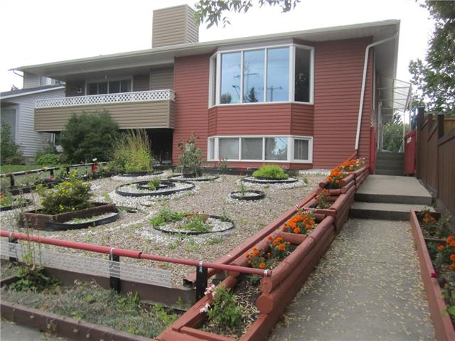 Long term owners say sell! One of a kind attached bi-level duplex with 24x20ft double detached garage on a large & well manicured 25x160ft west rear lot. The main level features a well-lit front living room with bay window, seperate dining area with tiled floor, a huge country style kitchen with bright skylight, a large flex room with fireplace & an additional bonus custom rear addition room which leads out to the fully fenced backyard. The lower level has been modified to feature the master bedroom with large walk-in closet, full bathroom, another two big bedrooms and the laundry / storage room. Recently painted thru-out and owners just moved out, so you can move-in today! Perfect location as you are less than a five minute drive to downtown, close to Westbrook shopping, the LRT plus just steps from Edworthy Park. Great for the Downtown professional or investment property for students attending Mount Royal University. Call today to view and take advantage of record low interest rates!!
