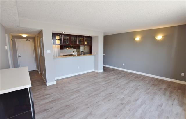 Lovely renovated condo with a real WOW factor located within walking distance to trendy Kensington ave.  New vinyl plank flooring throughout, completely renovated bathroom with granite counter tops italian tiles and deep soaker tub.  Modern closet doors in the bedrooms, gas stove, brand new microwave hood range.  There is a gym on the main floor that has undergone recent renovations. HUGE private storage in the basement and the small storage unit outside the door to the suite belongs to the suite.  Walking distance to SAIT and the Jubilee.  Lots of recent building improvements!! Nothing to do but move in and unpack
