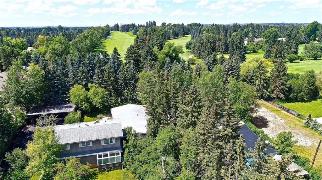 """Rare development opportunity! Just under 1 acre (.8) """"Private"""" treed lot backing onto the 13th tee box of the  Calgary Golf and Country Club. This lot could accommodate up to 5 luxury bungalows, a small townhouse development, a lowrise apartment condo complex, or a large estate home with a guest residence. A luxury bungalow development project was approved in 1997. The lot size is 34,833sf with 130' width backing onto the golf course. Listing Realtor is related to the Seller. Please do not drive onto the property with authorization. Thank you!"""
