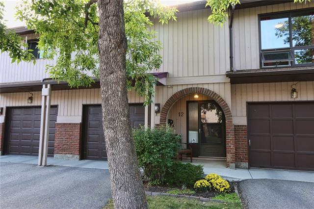 Great condo with 4 levels developed and an attached garage, backing onto a park with mature trees. Nice sunny fenced back yard with perennials beds and patio to enjoy. The basement level has large windows and lots of storage and closets and can be used a second bedroom. The main floor offers a half bath and the laundry and access to the finished garage also with lots of storage. The main floor features a large living with a stone fireplace and dramatic vaulted ceiling plus it looks out onto the park. The upper floor showcases a cozy u shaped kitchen, dining area and loft that overlooks the living room below. The bedroom has a four piece ensuite and large closet. Other features include lots of railing, tile floors plus parquet in the kitchen and dining, tongue and grove ceiling in the living room. Quick possession.