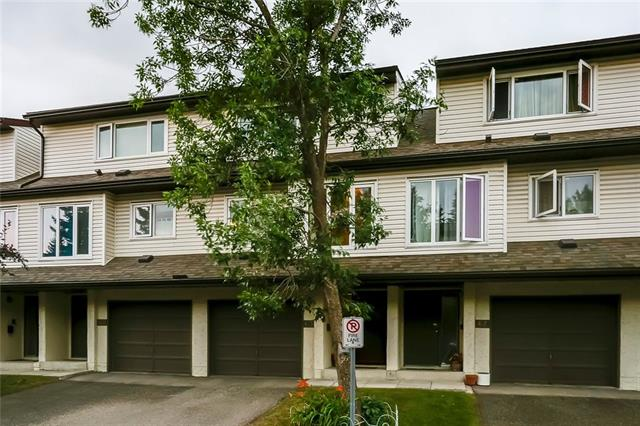 Seller is offering 6 months free condo fees! Excellent value for this spacious townhome in the popular community of Ranchlands. Walk to schools, shopping, parks and major transit lines for a stress free commute! The complex is extremely well managed and has undergone major renovations including; shingles, windows, maintenance free balconies, fencing and soon to be installed new garage doors. Inside you?ll discover an exciting floorplan & lots of updates throughout including; refreshed kitchen cabinets, flooring, bathrooms, furnace, hot water tank & more. The master bedroom is huge, enjoys wall to wall closets and has direct access to the full upstairs bathroom. There are 2 spare bedrooms one of which underwent a modification to add a hallway window for extra light! The walk-out basement is rare in this complex and adds a lg rec-room with cozy fireplace. Patio doors access the fully fenced and landscaped yard with patio. Even the car will be pampered in the attached garage! Well managed. Good reserve fund.