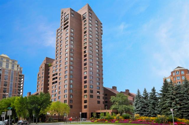 Superb location in Eau Claire Estates, steps to the downtown office towers, this 2 bdrm suite has TONS of space - 1600 SF, GREAT views of the Bow River & Prince's Island Park, all waiting for your renovation inspiration! The living rm & dining area are huge, w/windows & balcony to take in the view. The kitchen is large - eating area, lots of counter space & centre island. Spacious master bdrm offers a walk-in closet & ensuite bath, sliding pocket doors to the large den (could be used as a guest bdrm), & 2nd full bath. Titled underground parking incl. The building offers residents THE BEST amenities - 24 hour concierge service, on-site health club with swimming pool, hot tub, exercise rm & newly renovated change rooms, putting green, sun deck w/BBQ's, gorgeous central courtyard & of course a premier location in Eau Claire. Steps to the Bow River pathway, Eau Claire Market & 1 block to the +15 walkway network. Call to View Today!