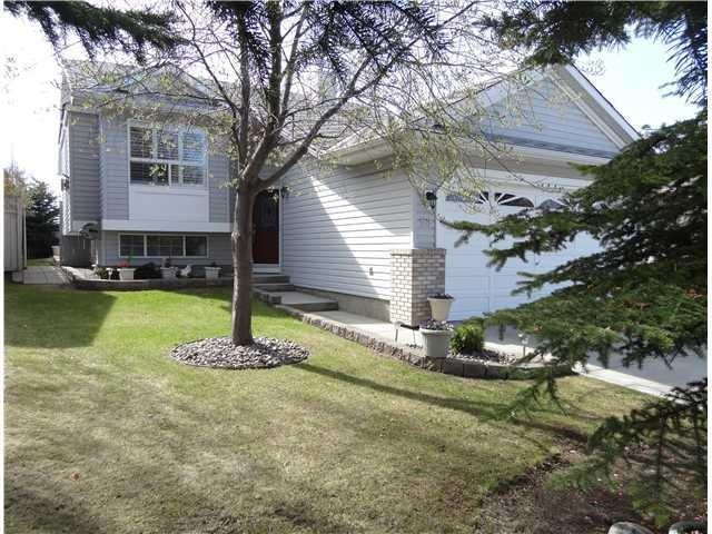 A Rare Find!  5-bedroom home for under $450,000 in Lake Sundance! Large fully developed bi-level, which has been meticulously maintained and is ?turn-key ready?. This optimal floor plan has 3 bedrooms up, a spacious living room, great sized eat-in kitchen with peninsula island, lots of cabinetry, pantry and a garden door to the sunny west facing deck. Yard is landscaped, fully fenced and offers attached storage shed for additional storage. The main living area is tough to beat with vaulted ceilings, gas fireplace, and large windows with built in window shutters! The professionally developed lower level features a huge rec room with gas stove/fireplace, 2 additional bedrooms, a 3-piece bath, and great storage.