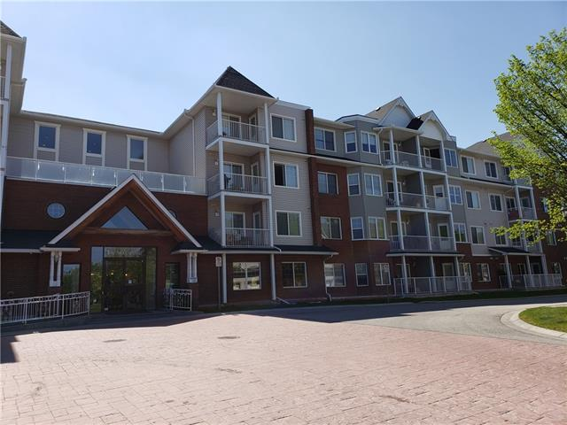 This amazingly laid out, one of the kind, showhome-like condo is located in the highly desirable Caledonia on the Waterfront. This unit has two large bedrooms and two bathrooms, is minutes away from the pond and a pathway system. This gorgeous, spacious condo is located in the end unit on top floor and features 10-foot ceilings throughout 12 foot ceiling in the breakfast nook. You can enjoy the stunning mountain views from the dinning area. The kitchen is equipped with granite counter tops and a large island with brand new Stainless Steel Appliance package (New). The gorgeous functional master bedroom features a walk-in closet and 4 piece en-suite bathroom. There is in suite laundry, laminate flooring, a separate 3 piece-bathroom and the balcony. This is a truly rare find on the condo market: Beautiful, in  pristine condition, and conveniently located in one of the Calgary's most popular communities.