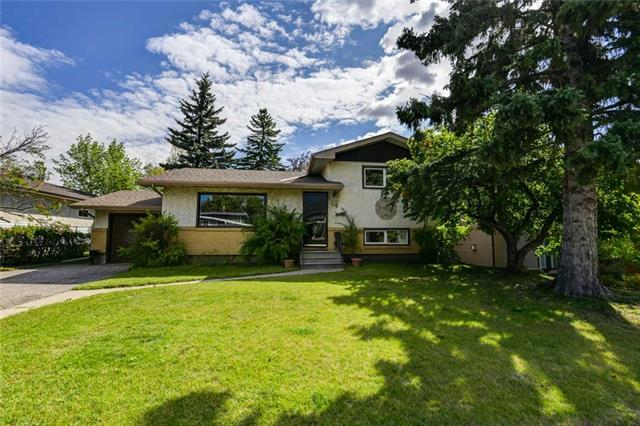 A classic 4 level split on a large lot in a quiet location within the heart of a mature northwest neighborhood. Developed on all 4 levels, plenty of space for everyone. Lots of storage, too! Hardwood flooring through upper level and living & dining rooms. Sunny patio door provides access to deck & large, fully fenced private yard.  Ideal for pets! Perfect for summer BBQ's! Single attached garage & covered patio. Windows, roof, sewer line & furnace have all been updated. Convenient location just steps away from a direct bus to the University. Easy access to SAIT, city center, Foothills & Children's Hospitals, schools, groceries & amenities.