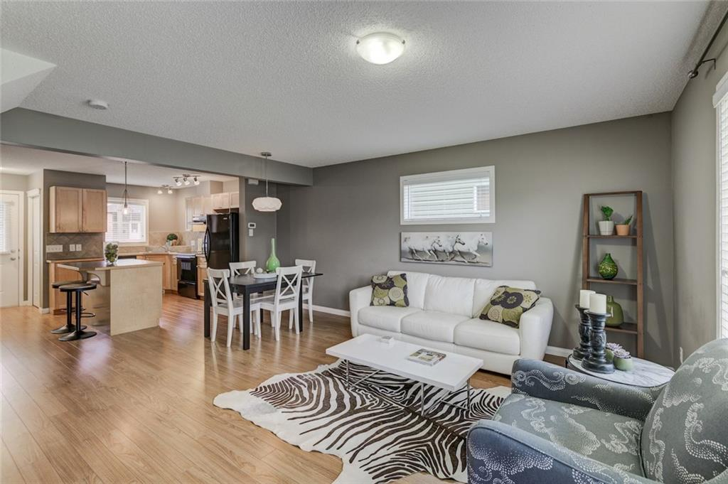 AVAILABLE FOR QUICK POSSESSION! Seller is offering a $2500 incentive to be used towards property taxes or condo fees! Smart & stylish two-story END UNIT townhome with 3 bedrooms up! This townhome has been incredibly well cared for. You?ll love the modern light fixtures & the low maintenance laminate flooring. Backing onto green space, you have privacy, peace & quiet. Upstairs, the master bedroom is well-appointed with a spacious closet. Two additional large bedrooms & a 4 piece bath complete this space. The main floor has a ton of natural light due to the extra windows that an end unit offers. The basement is fully finished with an open recreation area. Lower laundry, rough-in for a bathroom & extra storage can also be found in the basement. 2 parking stalls are included directly in front of this awesome condo. Great location, close to schools & shopping, but far away from traffic & noise. You?ll feel right at home here!