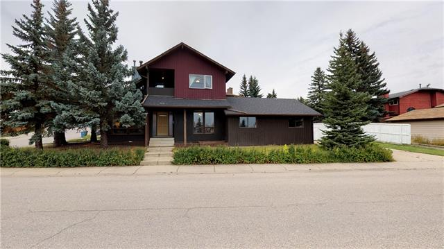 *** Open House Sunday Sep 15 from 2 to 4  *** Location! Location! ***Welcome to this amazing home in the very sought after neighborhood of Edgemont on a large corner lot under $500K. This beautiful 5 bedrooms & 2600 sqft of living space is surrounded by the best schools in Calgary! This home is close to Nose Hill Park, Transit and Shopping and has been updated with newer shingles (2015), newer windows and new hot water tank. The main floor welcomes you with a large Vaulted ceiling living room, dining room for your favorite guests, a large kitchen with granite counter top, Massive family room with wood fire place for those cold winter nights plus main floor laundry. The second level features 2 spacious bedrooms, full bathroom, huge master bedroom and a private balcony. The basement has two huge bedrooms, full bathroom and another massive rec room for the whole family to enjoy.