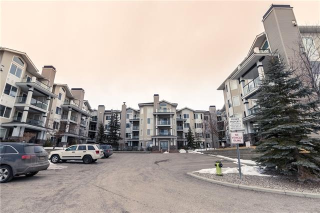 Fantastic 2 bedroom, 2 bath unit that backs onto greenspace - located in the prestigious Pavilions of Rocky Ridge. Very functional floor plan, in suite laundry, titled underground parking in newer building. Great amenities with theatre, rec room, exercise room, board room and even a salon! The 2 bedrooms are separated by the living room making it perfect for a roommate. This home is located just minutes from lake amenities, walking paths, Royal Oak Shopping and the Tuscany LRT station. Why rent when you can own? Don't miss this well priced opportunity!