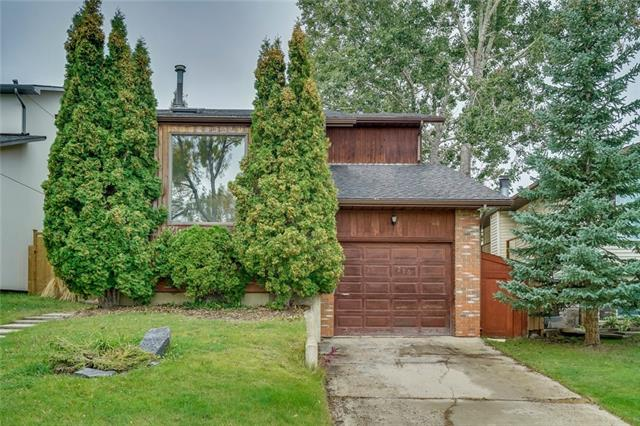 Great neighbourhood, quick commute downtown (express bus!) & just steps to amazing Nose Hill Park! This lovely home has over 2,250 square feet above grade - a rarity in MacEwan. New hardwood floors run through the entry into a large, vaulted living room, complete with two skylights, giving you amazing natural light. Den off the kitchen can be used as a large dining room. The bright kitchen boasts new appliances, new laminate countertops & painted cabinetry. Cozy family room off kitchen with brick fireplace. Main floor laundry with HE front load machines. Upstairs features a large master with walk-in closet & full ensuite. Large 2nd & 3rd bedrooms plus full bath w/ heated floors complete the upper level. Enjoy sunny evenings on the newly built West-facing deck & professionally landscaped backyard. A large, undeveloped basement with bathroom rough-in awaits your final touches. Park in the attached single garage, long driveway or around back on gravel pad.