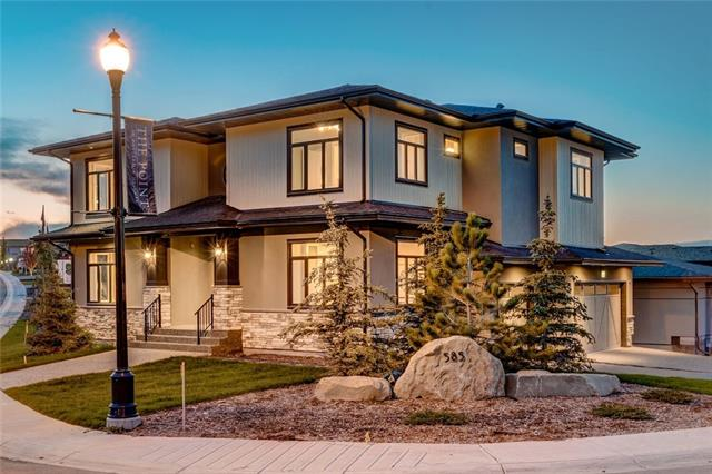 Grand, opulent, executive home by luxury home builder, Vaastu Homes. Situated on a corner lot with a unique curb appeal & views from almost every room. Patterson's protected environmental oasis is close by so you can enjoy walks on the ravine trails. No expense has been spared in this 3 bed/3.5 bath home with over 3200 sq ft of living space & triple car garage. The great room is simply stunning with an open to above concept, 2 story windows flooding the space with natural light, exotic stone double-sided gas f/p with custom woodwork, open white oak  staircase with glass railings & high-end light fixtures. The elegant gourmet kitchen has gold fixtures, thick Calcutta marble island, Jen-air SS appliances, butler pantry, herringbone backsplash, floating shelves with pot lights & is open to the dining room making this a great space for entertaining. The large office overlooking the green space is a dream for those who work from home. There is also a striking contemporary powder room. See additional remarks...