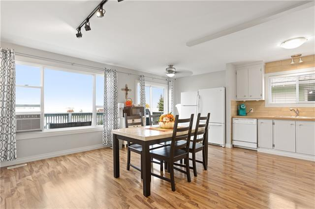NO CONDO FEES! Check out this spacious, move-in ready bilevel with 5 BEDROOMS and 3 BATHROOMS! The main floor has a wide open kitchen and living room with lots of cabinet and counter space and plenty of room if you wanted to add an island. Large windows and sliding door lead out to the extended deck looking out to Lions Centennial Park and wide open spaces. Enjoy the amazing sunsets and mountain views. Upstairs you will enjoy three bedrooms and two bathrooms including a master with His and Hers closets and ensuite. The lower level is very functional with large rec room, two oversized bedrooms that could be used for office/play room/den, another full bath and laundry. There have been renovations done throughout so all you have to do is move in and enjoy!! Outside you have the convenience of two stalls in the front and extra parking in the back for more cars or your RV. The backyard is very private and you will enjoy the deck and fire pit. A great home, at a great price, in a great community!