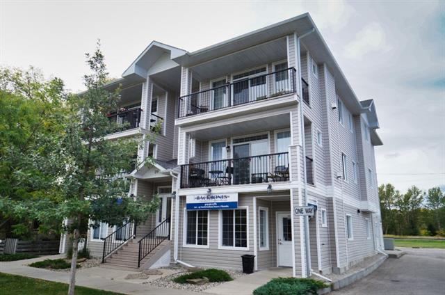 Living in the vibrant Business District of Old Towne Okotoks doesn?t get any better. There are Only 4 private suites in this building and this Second Floor Unit (minimal Stairs) has 1142 sq feet from front to back so you get plenty of sunshine! Enjoy the markets, classic car show, Annual parade, Boutique shopping, Restaurants and Coffee Shops right outside your front door. You?ll never miss an event again! This executive apartment boasts an open concept design with 2 spacious Bedrooms and 2 Full bath, stunning New Plank Vinyl Flooring, New paint and new Hot Water tank, custom curtains, in suite laundry. Gorgeous kitchen with large entertainment area for your guests. The outdoor deck is a great space to relax and view the activity or grab a coffee from Home Ground where you will no doubt become a ?Regular.? Private parking lot, quiet & secure building, nearby bike and running trails. A Great Space to call home for those with energetic & cosmopolitan preferences.