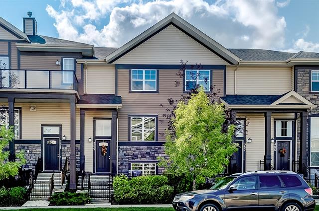 This beautiful townhouse in the desirable community of McKenzie Towne is the Cayenne model featuring the popular double master bedroom plan & includes A/C. Great location a few short steps to Shoppers Drug Mart, Inverness Pond & McKenzie Towne shopping area w/ all the amenities you need. Enjoy the sun on your front patio w/ room for furniture & bbq. Main level is open concept allowing for your modern living needs. The spacious living room at the front, dining area in the middle & kitchen at the back w/ full height cabinets, granite countertops, SS appliances, pantry & built in counter perfect for a coffee machine or liquor area. Powder room around the corner at bottom of the stairs. Upstairs the main master bedroom features a walk-in closet & ensuite w/ glass shower. Second master bedroom features a walk-in closet & ensuite w/ tub/shower. Rounding out the upper level is the laundry closet & display area at the top of the stairs. Lower level accesses the double attached garage & mechanical/storage area.