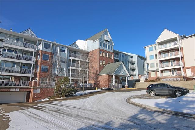 It just doesn't get any better than this comfortable 2 bedroom/2 bath condo in Hawkwood's Dreamview Village - this exclusive 55+ complex offering the best in adult maintenance-free living. Outstanding value for this bright & airy unit, in this coveted location overlooking a greenspace & the community gardens. Smashing West-facing home with beautiful mountain views, offering all new carpets & paint, large covered balcony with retractable awning & sensational residents amenities including the fully-loaded clubhouse & private park with pond & fountain. Great open concept design with living room with bay window & air conditioning, spacious dining room & white kitchen with tile floors & upgraded appliances including LG dishwasher & Samsung fridge. Master bedroom is a huge size with 2 big closets & ensuite with walk-in shower. The 2nd full bath has been beautifully renovated & features heated tile floors, Toto toilet & sleek glass/tile shower.