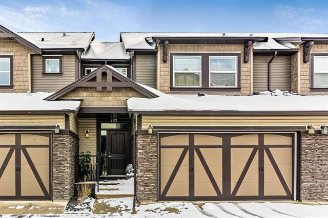 PRIDE in ownership is reflected throughout this IMMACULATE home in sought after Coopers Crossing - one of Airdrie?s premiere communities. This GORGEOUS 4 bedroom townhouse is loaded with UPGRADES. The large kitchen has STAINLESS appliances, GRANITE countertops, an eating bar and dark maple cabinets. There is a large dining area with a patio door that leads to your DECK. The living room comes complete with a cozy FIREPLACE. Upstairs you will be a grand master Retreat with VAULTED ceilings and a Luxurious EN-SUITE with a soaker tub, a separate shower and double sinks. There are 2 more bedrooms, another full bathroom and laundry on the top floor. The basement is Fully FINISHED with a large REC room, a 4TH bedroom with its own EN-SUITE. There is also ample storage. There is also a DOUBLE ATTACHED GARAGE! Don?t miss out on this AMAZING home at great price!