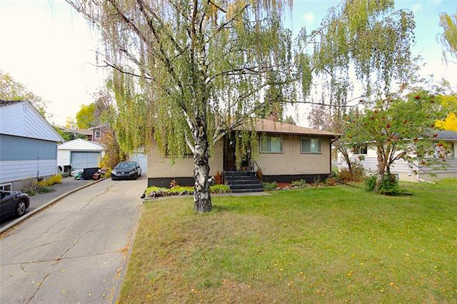 Attention investors! This is your chance to own a Recently RENOVATED gorgeous RC-2 60x100 foot lot in the heart of Highwood, a well-established family friendly community. This 5(3up/2down) bedroom bungalow has been recently upgraded in the basement with new flooring, paint and brand new bathroom.  Upstairs features immaculate original hardwood on the main level with newer paint & BRAND NEW TILED BATHROOM and Laundry. Recent Roof, some newer windows, recent hot water tank and oversized single garage. The basement features a recently updates 2-bedroom illegal suite with its own laundry room.  Private west-facing backyard. Drive by 479 Northmount Drive NW today or book a showing today!