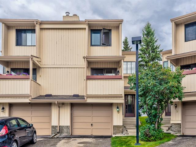 OPEN HOUSE SAT NOV 9 12-2PM * Welcome to this lovely 3 BEDROOM townhome with OVER 1,390 SQ.FT of developed living space! You'll appreciate this QUIET LOCATION, especially the fact that it has a SOUTH FACING deck and is BACKING GREEN SPACE. Open concept with neutral colours; the main floor offers a large living room, wood burning FIREPLACE and a deck on each side facing both north & south. The dining area can fit a large table for friends and family. The kitchen offers ample counter space and lots of cabinets! The patio doors open up to the 2nd deck where you'll enjoy the privacy from the trees. Upstairs you will find the master bedroom with a 3 pc en-suite, two more bedrooms and a 4 pc bath. The lower level is finished and offers a flex room, laundry and access to your over sized ATTACHED SINGLE GARAGE. NEWER WINDOWS (2009) and patio doors to deck (2010). New Central Vac (Electrolux). Well managed complex in a great community! Book your showing today!!!