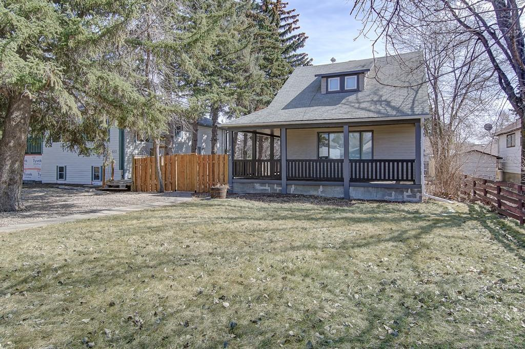Cute home with charming wrap around veranda and new fence. READY TO MOVE IN AND ENJOY! The yard has amazing mature trees a double detached garage and RV parking! Bright main floor with laminate. Spacious family room. White kitchen with lots of counter space. Second floor has 2 bedrooms and 1/2 bath. Master bedroom with walk in closet and nook area... perfect for a new baby or office space. Additional space in the basement ready for development. Newer roof, PVC windows, hot water tank, plex piping and new sewer line out. Don't miss your chance to call this one home! Rockyford is located 15 minutes east of Strathmore Note Bathrooms Have been newly renovated and fresh paint.