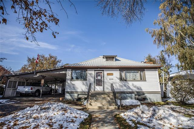 Here is a great opportunity to own a home in the community of Nanton, just 40 minutes south of Calgary.Located on a 120 x 70 foot lot, this home is ready for a family to call it home.Through the front door you are greeted by a cozy living room,down the hall you will find a 4 piece bathroom & 2 bdrooms,bright kitchen and dining area.A sliding door takes you onto the enclosed deck w/ handicapped ramp access and storage area.The partially finished basement has another bedroom with built in bunkbeds, 4 piece bathroom,cold room,laundry room and tons of room for storage.Top floor is home to your 4th bedroom.Side door of home opens to a large multi-purpose room w/ it's own gas heater.This room leads to the basement or up the stairs to the main living area. Huge private backyard with mature trees, plenty of room for further landscaping,back alley access,additional vehicle parking and room to park your trailer.Covered double car port with seating area. Lots of potential in this home. Call to book a showing today!