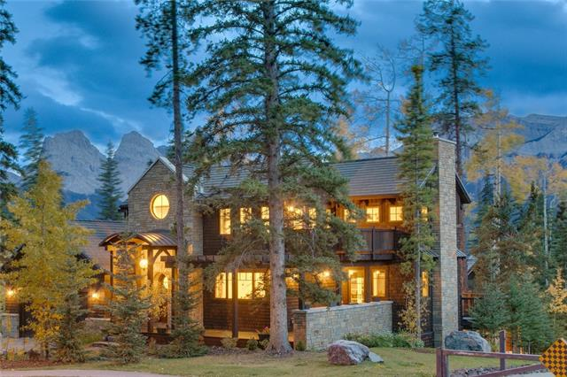 An architecturally stunning home in the luxury resort of Silvertip in Canmore. Surrounded by golf greens and mature trees in a quite neighbouhood. This 3 bedroom 3,546 sq ft home was made with beautiful aesthetics as well as practicality in mind, that can be found in the details. (See additional document, with list of many features) Designed to maximize outdoor space with an oversized main floor deck facing glorious South views of Three Sisters. When inside, you still feel like you are part of the outdoors with a full wall of south facing windows in the living room, made grander by the soaring vaulted ceilings and the suspended spiral staircase, which is a work of art in itself. The open concept living/dining room/kitchen is a well laid out gathering place for family and friends, cozying up in winter to the limestone wood burning fireplace. One can retreat to the central circular library or relax in the large outdoor sunken hot tub. The home comes turnkey, move in ready.