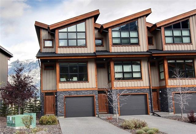 For more info click Multimedia - Charming 3-year-old, end unit townhouse. 2 ensuite bedrooms plus den, 2.5 baths, open kitchen-living-dining w/ gas fireplace, pantry, deck w/ a gas hook-up. Indoors garage plus 2-car driveway. Enter on the main floor to be welcomed by the stunning unobstructed views on BOTH SIDES of this townhouse! With a Nature Easement right behind it, every window offers breathtaking mountain views. Steps away from a playground, dog park, frisbee golf course, and mountain biking / x-country / hiking trails! With extra storage and workshop area for all your toys by the insulated indoors garage, a deck equipped with a gas hook-up for BBQ, and panoramic views - this is THE perfect mountain getaway! Elementary school 1.4km away, 5 mins walk to public transport, in a very quiet neighbourhood. - For more info click Multimedia
