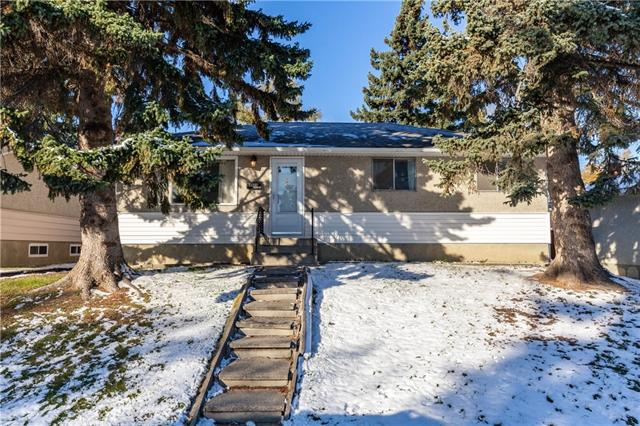 Great opportunity to own this bungalow, FIRST TIME ON MARKET! Apart from the almost 51' x 100' lot size, this home has TONS of potential starting with an inviting living room off the front, and eat-in kitchen with stainless steel appliances. You will also find a a good sized master bedroom, 2 additional secondary bedrooms and a full bath on this level.  The basement is developed with a LARGE rec room, 2 additional bedrooms, PLUS half bathroom. The west-facing backyard leads to an OVERSIZED DOUBLE GARAGE PLUS CAR PORT to park your boat, or extra vehicle. Greenspace, and tons of amenities including transportation, schools, shopping and much more within walking distance. PRICED TO SELL. Call today to view!