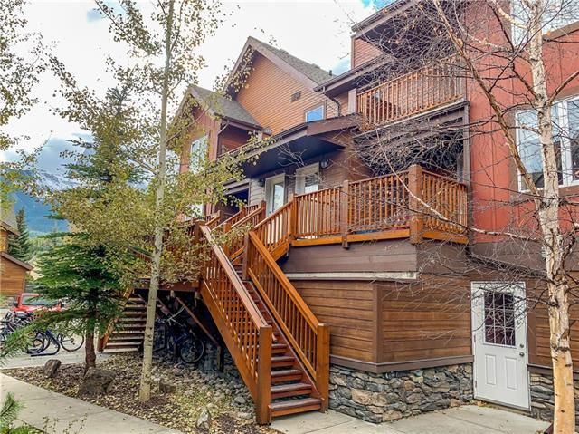 Located just a short walk to the Bow River and downtown Canmore, this residential home enjoys a quiet location set back from the street, terrific mountain views, and quality modern finishings. This top floor townhome allows you your own front door, and no unit above you. The elevated views are spectacular, and the calm, tree-lined approach to your front door belies the proximity to downtown. Two balconies to the east and west invite you to enjoy morning coffee in the sun, or an evening sunshine beverage. One covered parking stall plus a secure storage locker provide practical living in an enviable package. If you're looking for a quality home close to downtown that is move in-ready, this just might be what you've been waiting for.