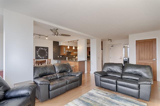 Updated 2 bed and 2 full bath unit in Point Mckay at Riverside Towers 1 on the 16th floor. A total renovation 5 yrs ago moved the laundry out of the kitchen to its own space in the hall, opening up the kitchen in the process, an additional shower was added in the master ensuite bath making  this unit complete with  two full baths. Large open concept design with eating bar at the island. Enjoy sunrises? This unit has endless beautiful sunrises  - see virtual tour for time lapse video for your new view. Granite throughout, engineered hardwood flooring, wood cabinets, and new doors to match, this timeless design ensures to impress you and your guests for years to come. 24 hour concierge services in this adult only building. Access to and reduced rates at the Riverside Sports club that includes tennis courts and spa. Underground parking with wash bay. Separate storage unit. Steps from the Bow River pathway system, easy access to major roadways, Foothills Hospital, UofC, Edworthy Park, and Kensington!