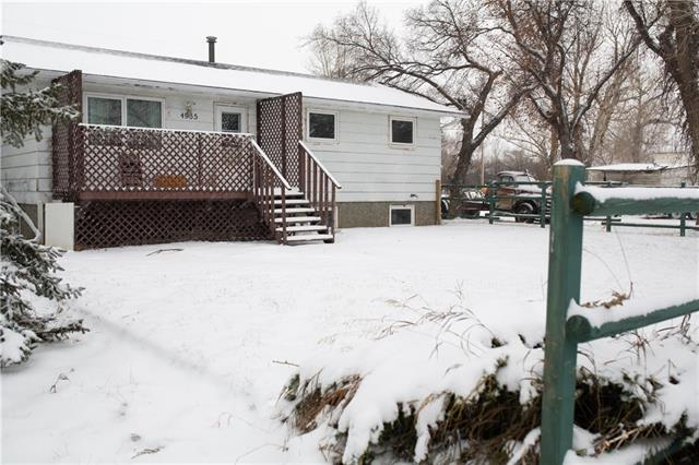 INCREDIBLE INVESTMENT OPPORTUNITY in the historic town of Stavely,  25 kms South of Nanton.  Minutes away from Pine coulee reservoir where you can fish, swim and enjoy summer beside the water.  This raised bungalow is centrally located within walking distance to the downtown shops on a 50 x 127 ft. lot. Separate entrance the basement.  Full kitchen and new flooring on the lower level.   Lots of room for parking, including space for an RV.  Take advantage of the low interest rates.