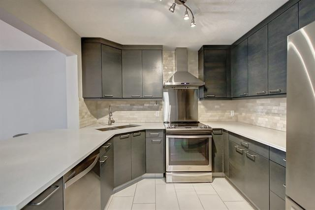Welcome to #309, 1415 17 St SE - renovated 2 bed 2 bath 1000+ sq ft apartment in the trendy neighborhood of Inglewood. The extensively upgraded kitchen boasts full height cabinets, eating bar, quartz counter tops and SS appliances. Large master suite has room for king size bed, walk-in closet with loads of storage and a renovated 4pc ensuite with new cabinets, tiles and counter-tops. Second bedroom is also a very generous size and is across from the renovated 3pcs bathroom.  Bright and open living room has a gas fireplace with all new tiles and built in wall unit.  Spacious dining room with new modern light fixture.  Insuite laundry has front load Samsung washer/dryer and room for storage.  This unit comes with 1 underground parking (#12) and an additional storage locker (#309).  Building features a car wash, bike storage and wheel chair accessible.   Ideally located steps from Pearce Estate Park, Bow River Pathways and two off leash dog parks. Voted #1 Neighborhood in Canada, come view this unit today.
