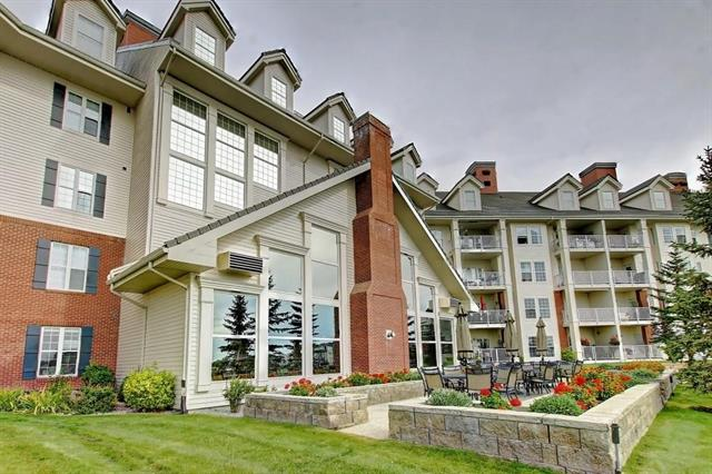 Welcome to 2000 Country Estates on the Cove.Condo fees include utilities (electrical,heating,water & sewage).Enjoy this beautiful large condo features over 1034 Sq.ft total living space w/ Maple cabinets,plenty of counter space,newer appliance package, breakfast eating area w/ central living rm & dining rm area,electric fireplace & walkout covered balcony,central air conditioning.Lg master bedroom that can hold lg furniture,walkthrough 3 pc bath flowing into large walk in closet.2nd br can be used as a bedroom /den area. Laundry & storage area in unit, heat underground parking w/ lg storage locker.40+ADULT building that is packed w/ tons of amenities,featuring the grand entry opens onto a large library,multiple games,craft areas.Indoor pool w hot tub,exercise rm,bowling alley,theater rm,large social rm w/ dance floor,wood workshop and car wash, guest suites & much more. Storage unit in front of parking stall.