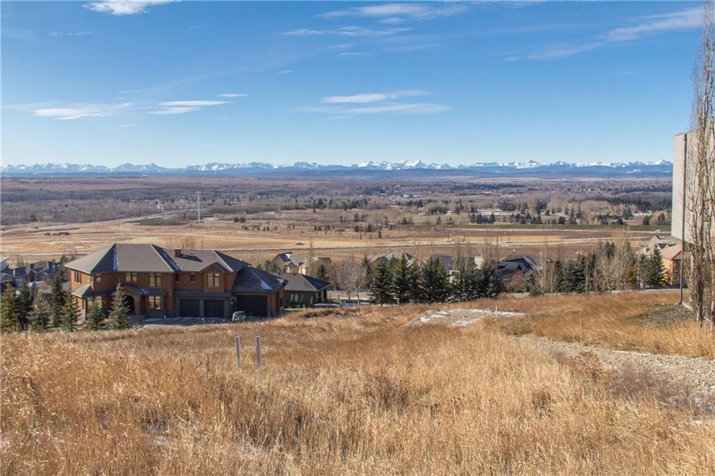 Unbelievable price for this rare almost 0.6 acres lot with magnificent mountain views! Bring your own builder & build your dream home in the gated community of Slopes. It's in close proximity to Downtown, Aspen Landing Shopping Centre, Westside Recreation Centre, Webber Academy & Rundle Academy.