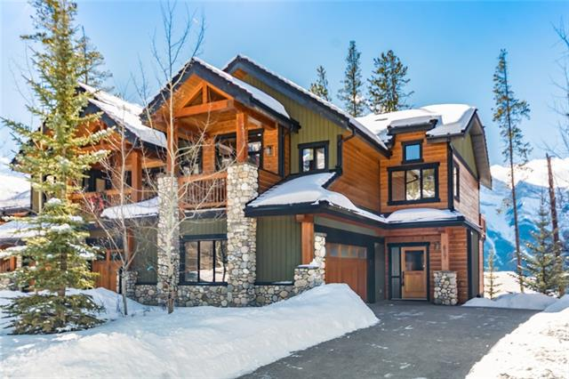 Short Term Rental Alert! Situated in a gorgeous location in Mountain's Reach, Silvertip's most exclusive area, this custom home offers spectacular unobstructed views! The well designed, open concept plan features 4 bedrooms with ample living space for entertaining, & nearly 3,400 SF over 3 levels with walkout. The main living level features a culinary kitchen with Sub Zero fridge & wine fridge, Viking 6 burner cooktop & dual ovens, as well as custom fir eating bar. In the vaulted great room you'll enjoy a wood-burning fireplace & floor to ceiling windows with stunning mountain views to the West. The upper level features the master bedroom with ensuite, & second bed with ensuite. Conveniently, the laundry room is also on this level. On the walkout level, there is a large family room complete with gas fireplace & wet bar as well as a media room, 2 more beds & full bath. 3 view decks, a patio with hot tub and large DBL garage completes this beauty.