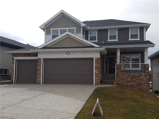 Need lots of bedrooms, bathrooms and parking? Total of five bedrooms, 4.5 bathrooms, triple garage, and over 3500 sq.ft total! BACKS WEST, quiet street, wide lot. MTN VIEW, WALKOUT bsmt, over 2600 square feet up, plus FULLY FINISHED down by the builder. Large EXPOSED AGGREGATE drive (can park 3 in garage plus 3 on driveway). Composite siding (more durable than vinyl)! Main floor has mudroom with 5 BUILT-IN LOCKERS & walk-through pantry. Office has french doors. U-shaped kitchen with large island, GAS stove with stainless steel venting hood, STAINLESS STEEL WALL OVEN, fridge and dishwasher, GRANITE counters. Tile, hardwood. Upstairs you will love the TOP FLOOR LAUNDRY with sink, BONUS Room, and 3 spacious bedrooms, all with WALK-IN CLOSETS. Ensuite bathroom with large soaker tub, 4' wide shower, and double sinks. WALKOUT basement is FULLY FINISHED with 2 more beds, 2 more baths! Rec room and games area. INSTANT HOT WATER, UPGRADED WINDOWS. Quick Possession.