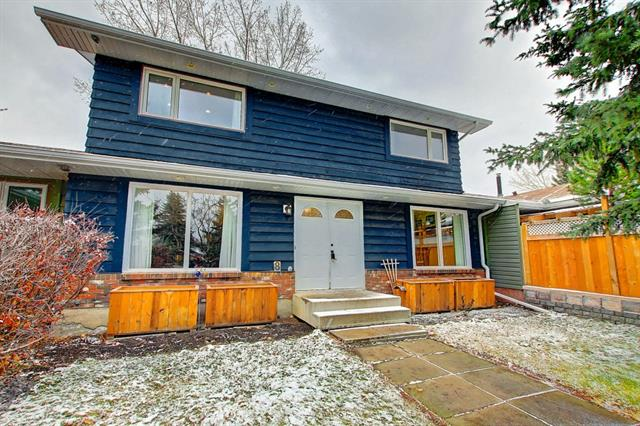 Welcome Home! This is the one you've been looking for. Fully renovated 3 bedroom, 2 1/2 bath family home backing onto Fish Creek Park!!! Around every corner you'll be impressed with the thoughtful upgrading. Hardwood & Vinyl plank flooring accentuates the main floor living area with a spacious living room, generous Dining room, brand new Kitchen with lots of granite & cabinets, breakfast bar overlooking the park and newer stainless appliances. The main is completed with a Laundry room, 2 pce bath and access to the large deck & patio to unwind on while enjoying nature. Upstairs boasts a huge Master suite with a wall of closets (don't miss the secret storage) and a 3 pce ensuite with heated floors, spa like shower and granite. 2 more generous bedrooms complete this level. The new basement development features a large Rec/Exercise room and Media room wired for surround sound for those relaxing evenings. All renovations completed with required permits. Enjoy your new home in this established lake community.