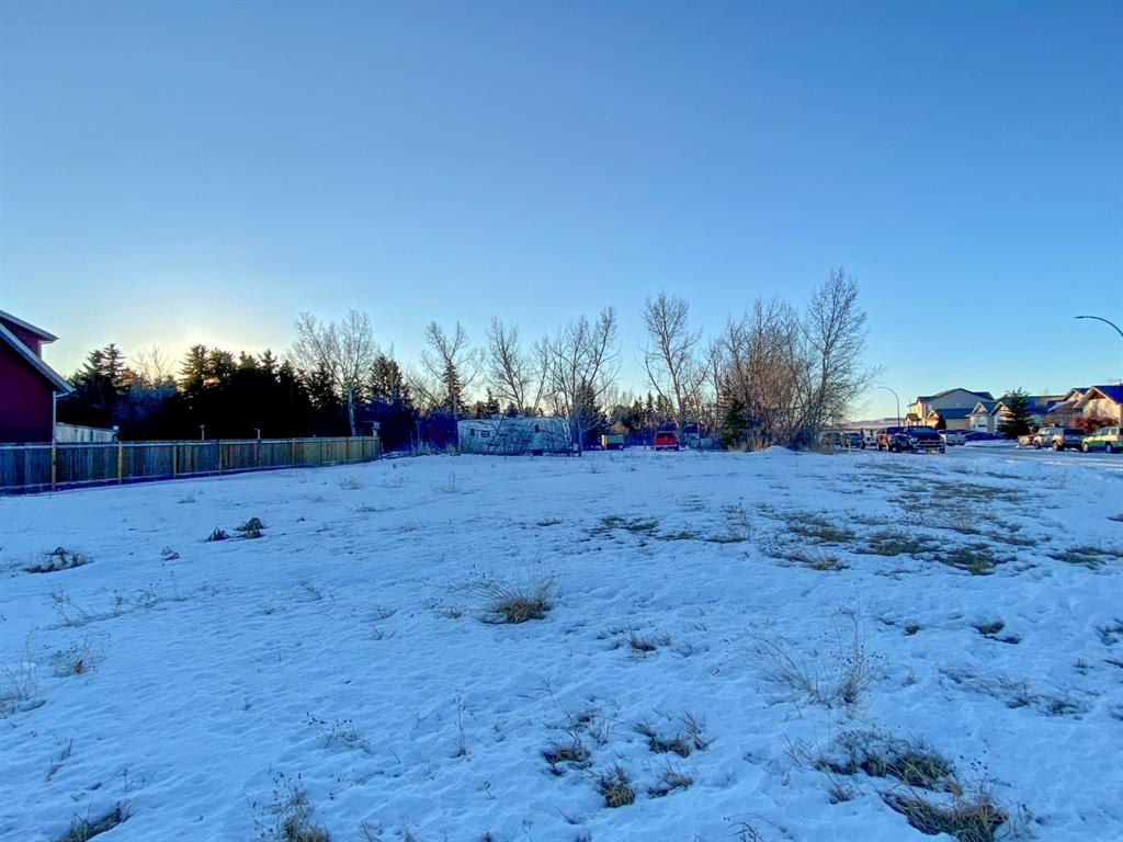 Potential plus on this 1/4 acre fully serviced lot on the corner of 22nd street and 27th avenue in Nanton. This corner lot provides an opportunity to build facing north or west and have access to your back yard from either 22nd or 27th. 99' x 107' with no building commitments, buy now and develop when it is convenient for you. Close to schools. Services at the lot line but to be verified by the buyer.