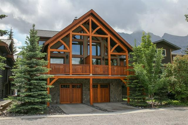 Built by Elk Run Custom Homes this town home with central A/C has timeless mountain architecture. Framed with Timber accents on the main floor the two storey windows allow for a spectacluar amount of natural light to flood in to the home while giving you breathtaking views of the Mountains. Entering the home this level has a large slate tiled foyer, access to the garage, laundry and a bedroom with a four piece ensuite washroom. The main level has a kitchen that every chef yearns for with 5 burner gas stove, stainless steel appliance package and granite countertops. The open plan main floor makes for easy entertainment while cooking and the large deck allows for dinner parties to enjoy the full views of the mountains while eating outside. The top level of the home has been saved for the palatial master bedroom and ensuite. You'll have incredible views of the Lady MacDonland range from the bed and a master ensuite with steam shower and soaker tub.